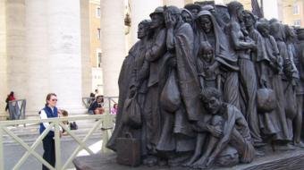 (Sr. Marge Perron, RJM at the Migrant Statue in Rome)