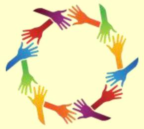 Multi-colored hands in a circle.